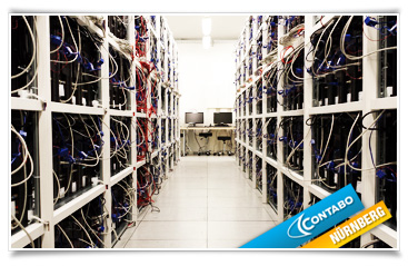 Server racks + working area in one of the data center rooms